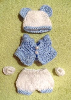 5-piece hand knitted Outfit for 8 OOAK Doll    (will fit most dolls of similar size)    Hand-knitted with great care and love from high quality yarn    Comprising of top, pants , shoes and hat    From smoke free home