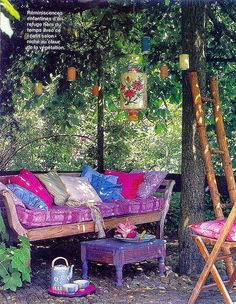 outdoor tea party - hanging birdcages or bottles with flowers, bohemian meets curiosities meets forest
