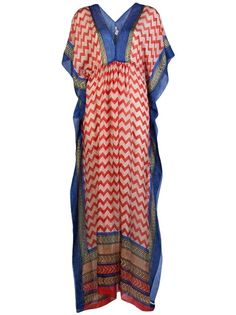 Navajo maxi poncho dress in nautical navy and red print from Lotta. This sheer silk caftan maxi dress features a V-neck and back, kimono sleeves, and drawstring waistline with side ties.