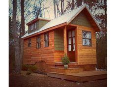18′ Cedar Rainscreen Siding Tiny House I like the way the utility trailer is covered by the lattice work. Nice job.