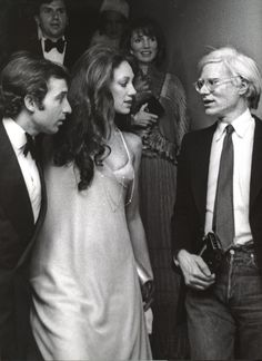 Rikky von Opel, Marisa Berenson, and Andy Warhol at Studio 54, c. 1970s. Lee Radziwill is behind Andy Warhol.