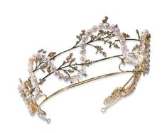 The second version Lalique made used fronds of small blossom interwoven with ropes of pearls