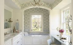 Long, lovely bathroom ends with deep and pretty tub