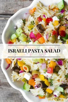 Israeli Pasta Salad is full of crunchy veggies, feta cheese, and olives, it makes a nice change from your old stand by! | http://theviewfromgreatisland.com