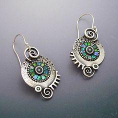 Sterling silver dangle circle twirl earrings by LizardsJewelry
