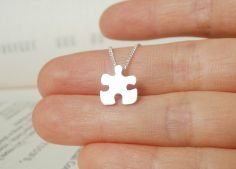 sterling silver jigsaw puzzle necklace, handmade in England from Huiyi Tan Handmade Designer Jewelry