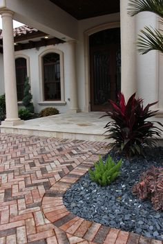 Beautiful home entrance. Clay brick paver walkway.