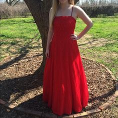 Red prom ball gown Bright red ball gown, beaded, has sequins, beaded spaghetti straps, worn once, like new condition, perfect for pageant or quinceañera. Sean Collection Dresses