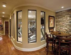 Awesome home gym! This would be great downstairs. Half gym/half man cave!