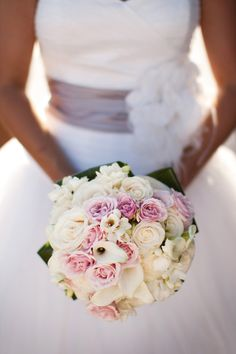 Calla lilies and roses -- the perfect bouquet for a summer wedding. Photo by Brent Pilgrim Photography.