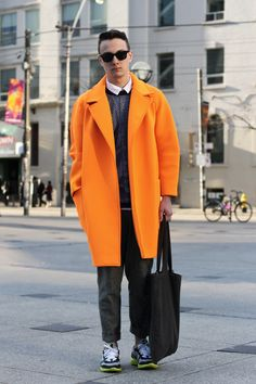 I need this neoprene coat in my life.... but WTF was he thinking with the shoes?