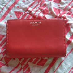 """HOST PICKCoach wallet GENUINE 5.5"""" x 3.5"""" genuine Coach wallet. 6 card pockets and 4 additional flat pockets in addition to a cash slot. Plenty of room in the 2 coin slots. Super cute coral color, sleek, simple wallet. Coach Bags Wallets"""