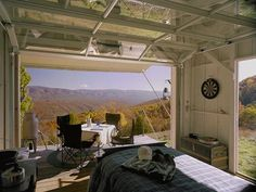 Cabin Fever: Small Retreats with Style (Note to self: OMG LOVE the garage door openings in a bedroom!! Sleepin' under the stars, but comfy and cozy : )
