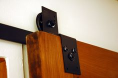 For some reason, barn door hardware costs a fortune (around four hundred dollars for a kit)...but this tutorial helps you put it all together for under one hundred dollars.