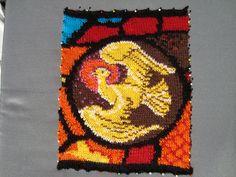 Knitted bird. Detail of a church window.