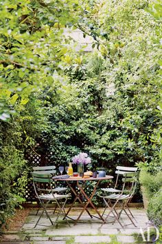 Breakfast awaits beneath a towering magnolia in the Paris garden of decorative-arts dealers Laurence and Patrick Seguin.