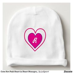 Cute Hot Pink Heart in Heart Monogrammed Baby Beanie. This cute design features a hot-pink heart outlined in purple and within a white heart outlined in hot pink. Personalize with the initial of your choice which will appear in a white cursive font.