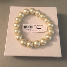 "NY & Co. Pearl Bracelet NWT; authentic New York & Company stretchy off white pearl bracelet; it measures 8"" in circumference without being stretched; gorgeous high quality elegant and classic piece of jewelry.  I ship on the same day or following morning so please try to ask all questions before buying or making an offer. Ty :) New York & Company Jewelry Bracelets"