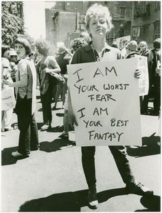 "Donna Gottschalk holds poster ""I am your worst fear I am your best fantasy"" at Christopher Street Gay Liberation Day parade, 1970. Photo by Diana Davies."