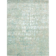 Create a fashion-forward foundation in your living room or master suite with this hand-tufted rug, showcasing a crocodile-inspired design.  ...