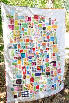 scraps appliqued to a quilt