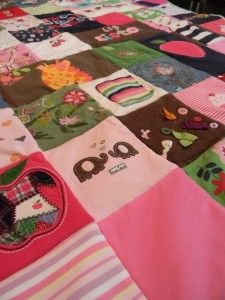 Baby quilt made from special baby clothes/items, including a small baby sock...what a great way keep memories of baby's first year....<3