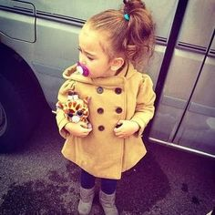 Cute baby girl in winter outfit