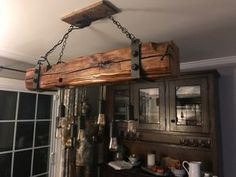 Hand hewn, reclaimed barn wood, beam light fixture, chandelier - This lamp is made from used wood, state of NY barn wood. The barn was built in It comes with - Plafond Design, Wooden Ceilings, Rustic Lighting, Rustic Light Fixtures, Dining Lighting, Farmhouse Lighting, Lighting Ideas, Reclaimed Barn Wood, Wood Beams