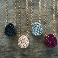 Glittering titanium druzy takes center stage along a rose gold filled cable chain. Natural, pear-shaped druzy is vapor coated with titanium to bring out a consistent, brilliant color. Druzy measures approximately 3/8 wide and 1/2 tall (10 x 12 mm). It is available in the following colors, from left to right: - Black - Rose Gold - Silver - Plum - Opal - Blue - Peacock Rose gold filled chain consists of delicate flat loops that add to the sparkle and shine of the piece. You choose th...