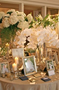 pictures on guest book table- this could be a bit nutty with the number of pics. but I want to do it so badly. My mom and dad, then them again with their current spouses, his parents, and the 4 sets of grandparents. Winter Centerpieces, White Centerpiece, Wedding Entrance Table, Wedding Reception, Altar, Hydrangea, Floral Wedding, Wedding Flowers, Picture Table