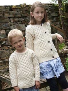 Take a look at our kid's crew neck aran sweater alongside our full range of Irish wool clothing. Baby Sweaters, Cable Knit Sweaters, Knit Cardigan, Irish Sweaters, Baby Bootees, Honeycomb Stitch, Irish Fashion, Knitted Baby Clothes, Couture