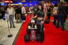 Guest posing with concept machine at SEMA 2012