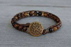 Wrapped Leather Bracelet with Tiger's Eye, Brass & Vintage Button - Brown Bronze Gold Fall Autumn Thanksgiving. $39.00, via Etsy.