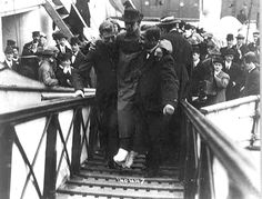 Harold Bride, surviving wireless operator of the TITANIC, with feet bandaged, being carried up ramp of ship. [source: Library of Congress]