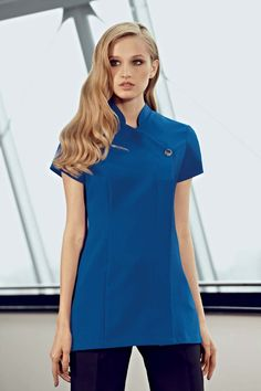 Ladies cobalt blue, one button healthcare tunic., concealed zip and action back for comfort. We are a supplier of nurse's and medical uniforms to the NHS, cosmetic surgeries, dentists and private practices.