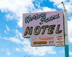 A fine art photo of the Western Scene Motel neon sign in Santa Fe, New Mexico.