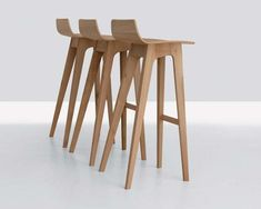 Oooh la la. Perfect wooden stool to complete the breakfast bar. Designed by Formstelle. Post Post modern bliss.