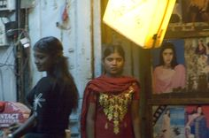 Description  English: Original text: Young women used in prostitution wait for customer/exploiters in Mumbai's red light district. They face routine violence from pimps and customers and a wide range of diseases and adverse health effects -- from sexually-transmitted diseases and tuberculosis, to rape, post-traumatic stress disorder, suicide, and murder.  Date  2005  Source  Images of Human Trafficking -- U.S. State Department    Author  Kay Chernush    Permission  (Reusing this file)…