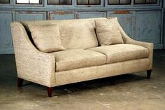 Belgravia Sofa with Tight Back with Spring Down Cushions and Two Feather Down Toss Pillows and Dark Walnut Finish Other Fabrics and Finishes Available COM Requires 14.5 Yards of Solid Fabric Arm Height 21.5