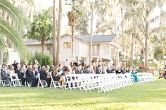 wedding guests sitting at ceremony  | Amy and Mikes Lakeside wedding | www.AmalieOrrangePhotography.com