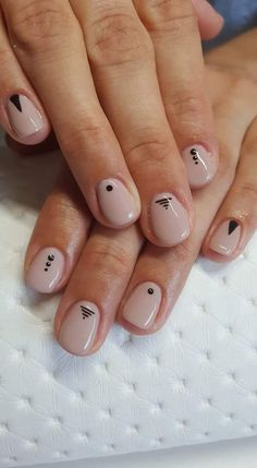 Nude nails with black details.