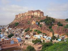 INDIA - Mehrangarh Fort - It is situated on a 122 meter (400 feet) high hill, has 36 meter high and 21 meter wide walls and is entered after crossing seven gates. The fort was initially built in 1459 by the founder of Jodhpur, Rao Jodha after he shifted his capital here from Mandore. However, most of what stands today dates back to the 17th century.