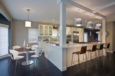 kitchen island with post, this really gives the open concept with still some separation
