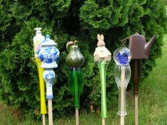 """DIY Garden Art on a Stick~~~start with a thin tall vase so you have a flat bottom for your """"treasure on top""""~~~"""