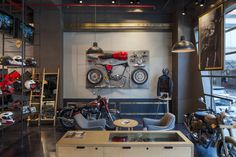Royal Enfield store by Lotus, New Delhi India motorbike Motorcycle Workshop, Motorcycle Store, Showroom Interior Design, Retail Interior, Visual Merchandising, Lofts, Bike Room, Retail Store Design, Coffee Shop Design