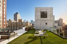 Residents also have access to a rooftop terrace with sweeping views of the city. The open-air space offers barbecue stations, three outdoor kitchens, fitness equipment and a screening area. Base Building, Mix Use Building, Building Exterior, Concrete Facade, Concrete Blocks, Innovative Architecture, Glass Facades, Rooftop Terrace, Facade Design