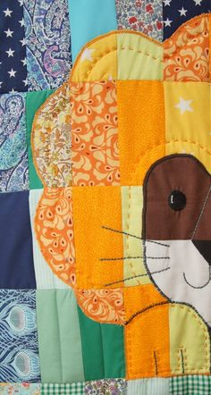 Creating the face on my lion quilt was difficult, but he is a pretty happy lion.