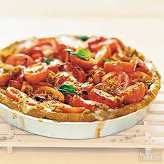 Try the popular combination of tomato, mozzarella, and basil tucked into a crust and baked to warm, melty yumminess. Serve as an appetizer or with a fresh garden salad for a light lunch or dinner.