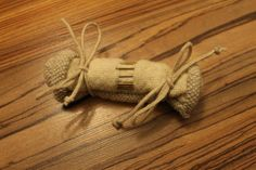 Package pincushion. The material is hand woven textil from wool. The hem is handwoven linen.