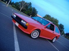 1987 Volkswagen Scirocco  My first car! It's not black and doesn't have racing stripes, but closest I could find to my beloved 'Rocco.